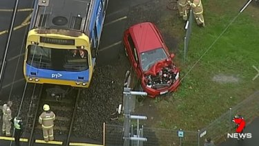 A woman has escaped injury after she drove into the path of a Frankston-bound train in Mentone.