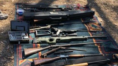 Police seize 40 guns, grenade and magic mushrooms in Queensland raid