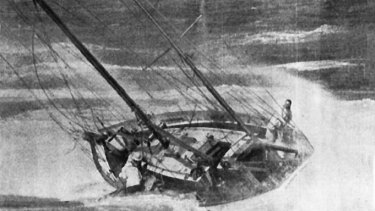 The Winston Churchill sinks in the heavy swell.