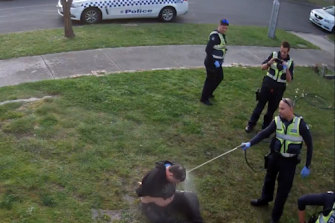 CCTV footage shows John, a disability pensioner, being hosed by a police officer.