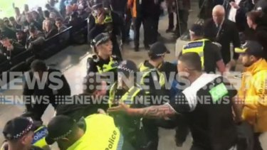 The blockbuster AFL clash between Greater Western Sydney and Collingwood has been marred by a violent brawl involving fans, security staff and police.