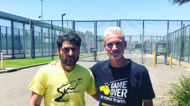 Farhad Bandesh with former Socceroo Craig Foster, after walking from detention a free man.
