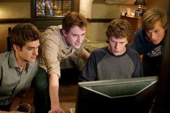 Andrew Garfield, Joseph Mazzello, Jesse Eisenberg and Patrick Maple in The Social Network,