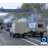 Disinfection trucks pass during a parade in Iran.