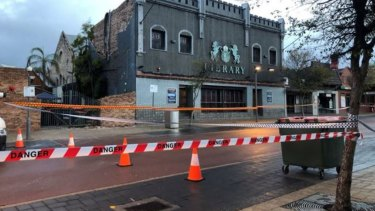 Police were already at the scene when the wall came down and rushed to keep punters safe.