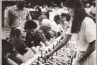 Katrin Aladjova, then 15, playing men in a 'simultaneous' chess game in a Brisbane shopping centre to help promote chess in the 1980s.