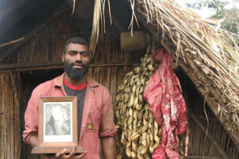 Village leader Siko Natwan with a portrait of Prince Philip.
