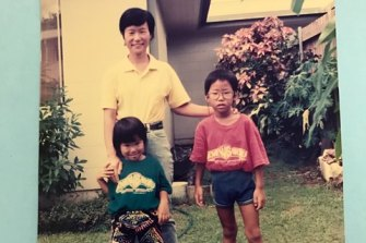 Cheng with her mother and brother Christopher in the backyard of the Cairns housing commission home where she grew up.