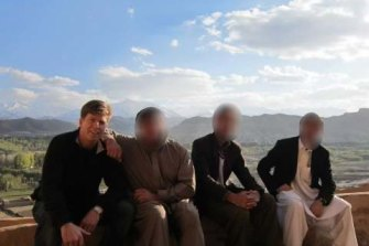 Geoff Peterson with some of his colleagues during his time working as an aid worker in Afghanistan. Faces have been blurred for safety reasons.
