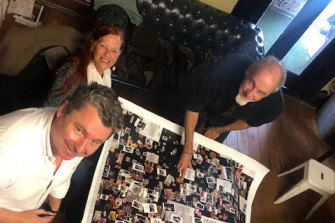 Prince Consort general manager Jason Hirt, Minnie Yorke and designer Chris Von Sanden (Ritchie Yorke Project) choose material for the suites at the Prince Consort Hotel.