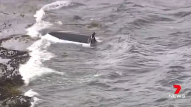 One man died and two people were rescued after a boat capsized in Sydney's south on Wednesday morning.