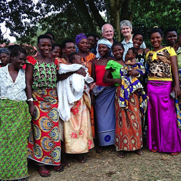 Doctors John Taylor and Barbara Hall with a group of happy post-op patients.