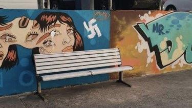 The defaced mural wall at Bondi Beach.