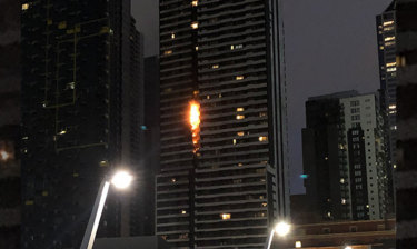 Flammable cladding on the Neo 200 apartment tower in Spencer Street burnt in February. The tower will now get public funding to remove any remaining flammable cladding.