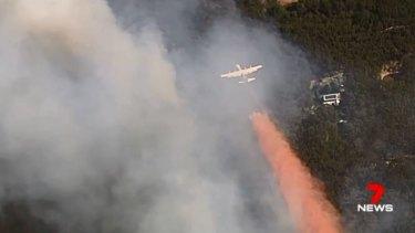A firefighting aircraft battling the Buninyong bushfire