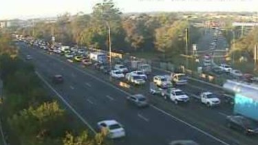 A south-facing traffic camera shows the extent of northbound delays at the Pacific Motorway's Rochedale exit at 7am.