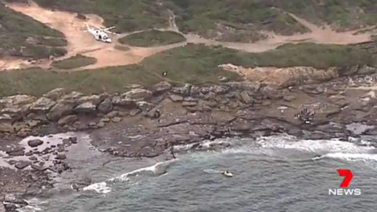 Two rescue helicopters joined the search after three people were thrown in the water when a boat capsized in Cronulla.