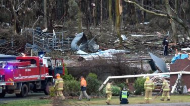 The fire brigade attends the site of a house destroyed by a tornado in Axe Creek.
