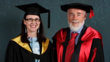 Allison Camille with Executive Dean Professor John Bartlett after graduating with a perfect grade point average of 7.