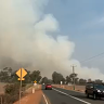 Gingin bushfire downgraded to a watch and act