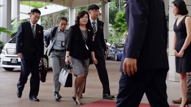 North Korean vice minister of foreign affairs Choi Sun-hee (third from left) arrives at the Ritz Carlton Hotel in Singapore to continue talks with the American ambassador to the Philippines, Sung Kim.