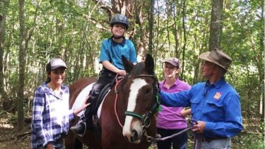 Oscar on his favourite horse, Clyde, at Brisbane's McIntyre Centre, where disabled children ride horses for therapy.