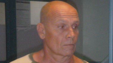 Queensland police are searching for Alan Lace, who is connected to the death of police dog Rambo in Maryborough.