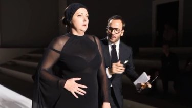 Celeste Barber is coached on the runway by Tom Ford in another collaboration between the unlikely pair.