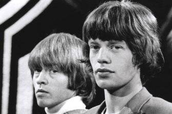 Brian Jones with Mick Jagger.
