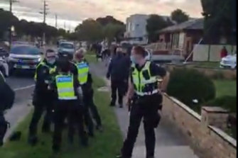 Video footage shows a gathering of large groups of people walking in Dandenong and police presence on the ground.