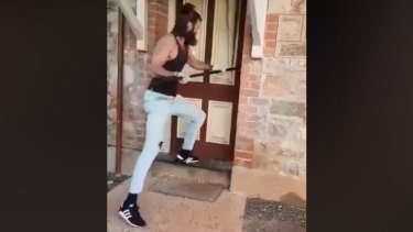 A still from the video shared by New Westralia members shows the historic courthouse door being forced open.