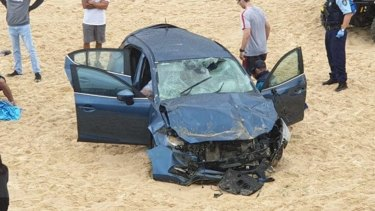 The scene after the car crashed onto Maroubra Beach on Wednesday.