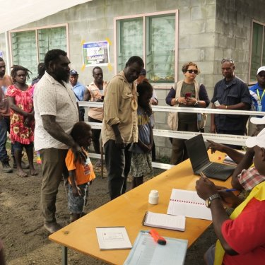 The first people to vote in the Bougainville independence referendum in the capital Arawa were the former commanders of the BRA (Bougainville Revolutionary Army) Ishmael Torama and Chris Uma, centre, standing with their children.