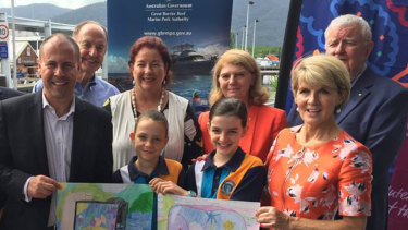 Josh Frydenberg and Julie Bishop flank two students at a Great Barrier Reef Foundation announcement in Cairns in April.