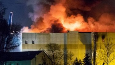 The fire burning ferociously in the Siberian shopping mall on Sunday afternoon.