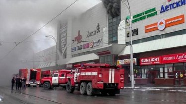 Firefighters outside the shopping mall. It is believed the fire started in a children's play area.