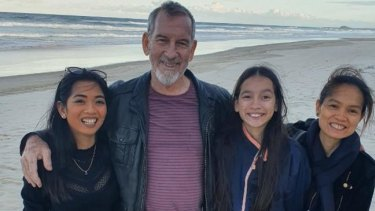 Sarah Caisip (left) is pictured with her father Bernard Prendergast, 11-year-old sister Isobel Prendergast and mother Myrna Prendergast.