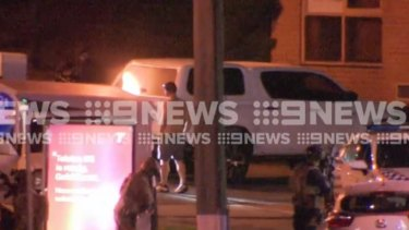 The end of a tense standoff at a Gold Coast service station overnight as the man surrenders to police.