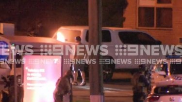 The end of a tense standoff at a Gold Coast service station as the man surrenders to police.