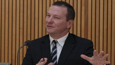 Labor MP Graham Perrett  wants replacement rail crossings to be funded equally by federal, state and local governments.