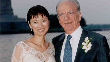 Rupert Murdoch and Wendi Deng pose near the Statue of Liberty after being married on board Murdoch's yacht in New York Harbor in 1999, 17 days after divorcing Anna.