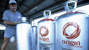 Origin has returned to a dividend and marked a return to profit as it continues to drive down debt levels.