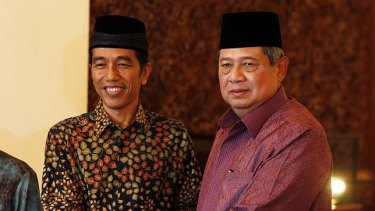 Outgoing president Susilo Bambang Yudhoyono (right), in 2014, with Joko Widodo.