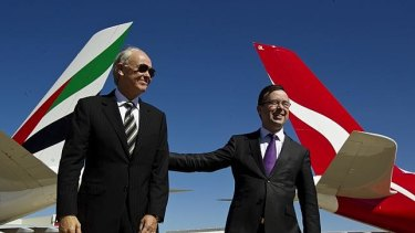Qantas Airways chief executive officer Alan Joyce (right) and Tim Clark, president of Emirates Airlines. Qantas customers can fly with Emirates between Australia and 50 one-stop codeshare destinations across Europe, the Middle East and North Africa. Both airlines have grounded their fleets as a result of travel restrictions introduced to try and stop the spread of coronavirus.