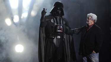 George Lucas with his most famous costumed villain, Darth Vader.