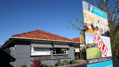 Falling house prices threaten tax cuts or surplus, as Australia's economy softens