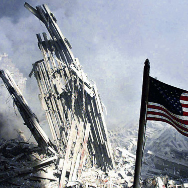 Am American flag flies near the base of the destroyed World Trade Center in New York, September 11, 2001.