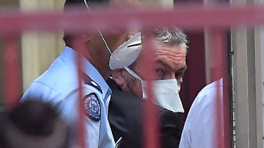 An outbreak of flu at the Melbourne Assessment Prison meant Borce Ristevski had to wear a face mask as he was led from the Supreme Court on Wednesday.