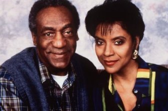 Bill Cosby in a promotional shot for The Cosby Show, pictured here with screen wife  Claire, played by Phylicia Rashad.