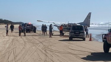 """The light plane made a """"low-impact"""" landing on Fraser Island and became bogged, according to paramedics."""